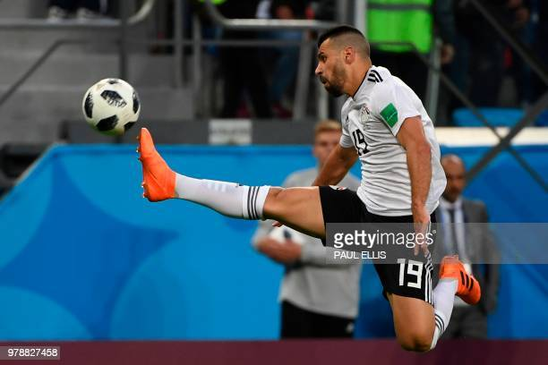 Egypt's midfielder Abdallah Said plays the ball during the Russia 2018 World Cup Group A football match between Russia and Egypt at the Saint...