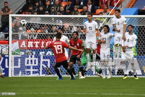 Egypt's midfielder Abdallah Said takes a free kick during the Russia 2018 World Cup Group A football match between Egypt and Uruguay at the...