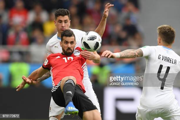 Egypt's midfielder Abdallah Said tries to control the ball during the Russia 2018 World Cup Group A football match between Egypt and Uruguay at the...