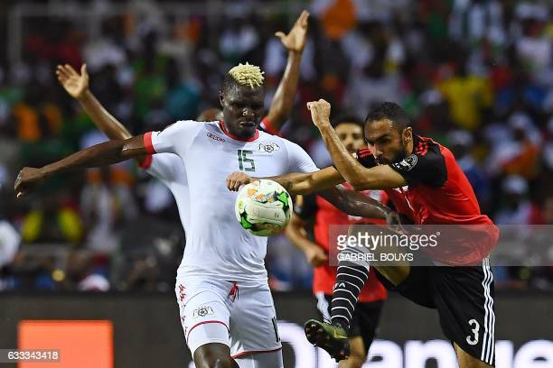 Egypt's midfielder Ahmed Elmohamady challenges Burkina Faso's forward Aristide Bance during the 2017 Africa Cup of Nations semifinal football match...