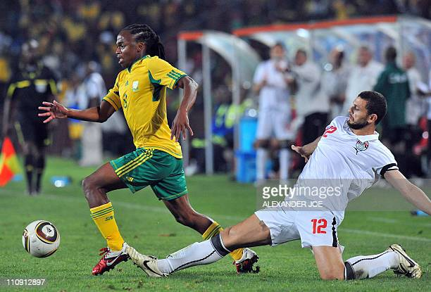 Egypt's midfielder Hossam Ghaly vies with South African midfielder Siphiwe Tshabalala during their Africa Cup of Nations 2012 qualifying football...