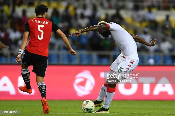 Egypt's midfielder Ibrahim Salah challenges Burkina Faso's forward Aristide Bance during the 2017 Africa Cup of Nations semifinal football match...