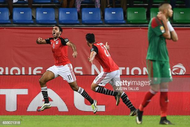 Egypt's midfielder Mahmoud AbdelMoneim celebrates with Egypt's midfielder Mahmoud Hassan after scoring a goal during the 2017 Africa Cup of Nations...