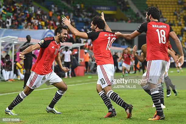 Egypt's midfielder Mahmoud AbdelMoneim celebrates with forwards Mohamed Salah and Marwan Mohsen after Egypt scored a goal during the 2017 Africa Cup...