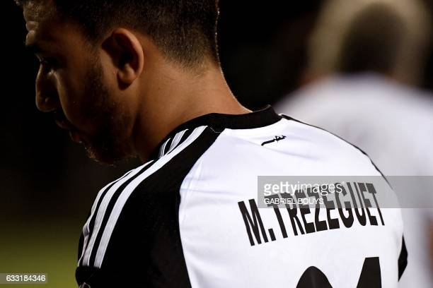 Egypt's midfielder Mahmoud Hassan wears a jersey bearing his nickname Trezeguet during a training session in Libreville on January 31 2017 on the eve...