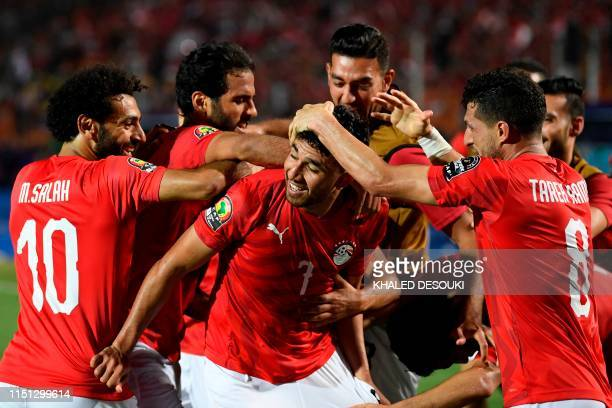 Egypt's midfielder Mahmoud 'Trezeguet' Hassan celebrates with his teammates after scoring a goal during the 2019 Africa Cup of Nations football match...