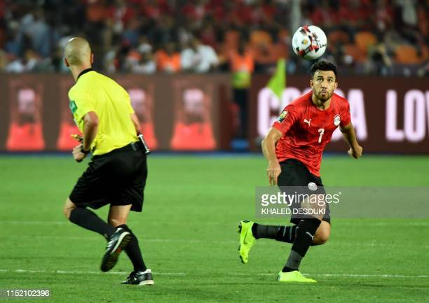 Egypt's midfielder Mahmoud 'Trezeguet' Hassan eyes the ball during the 2019 Africa Cup of Nations football match between Egypt and DR Congo at the...
