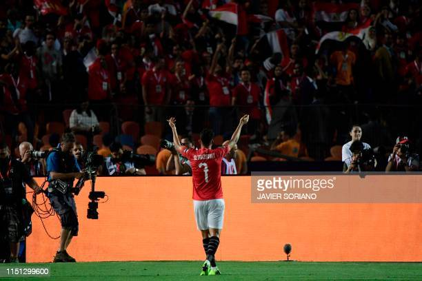 Egypt's midfielder Mahmoud 'Trezeguet' Hassan greets the fans as he celebrates after scoring a goal during the 2019 Africa Cup of Nations football...