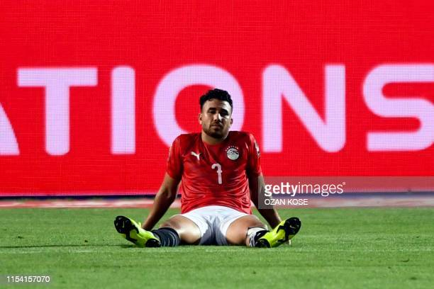 Egypt's midfielder Mahmoud 'Trezeguet' Hassan reacts after the 2019 Africa Cup of Nations Round of 16 football match between Egypt and South Africa...