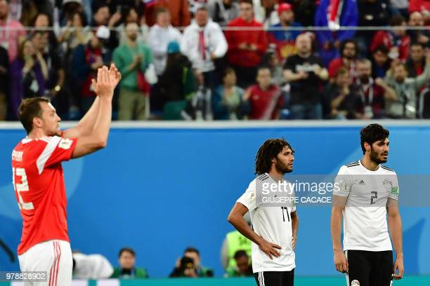 Egypt's midfielder Mohamed Elneny and Egypt's defender Ali Gabr react after Russia's goal during the Russia 2018 World Cup Group A football match...