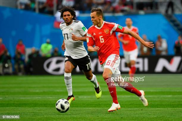 Egypt's midfielder Mohamed Elneny and Russia's midfielder Denis Cheryshev vie during the Russia 2018 World Cup Group A football match between Russia...