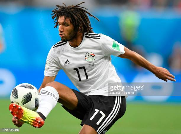 Egypt's midfielder Mohamed Elneny controls the ball during the Russia 2018 World Cup Group A football match between Russia and Egypt at the Saint...