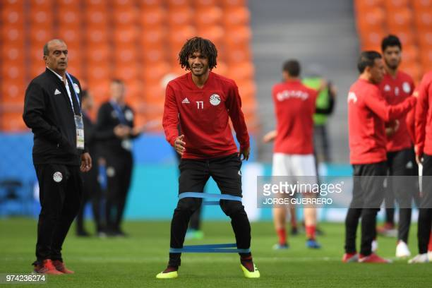 Egypt's midfielder Mohamed Elneny takes part in a training session at Ekaterinburg Stadium in Ekaterinburg on June 14 a day ahead the team's Russia...