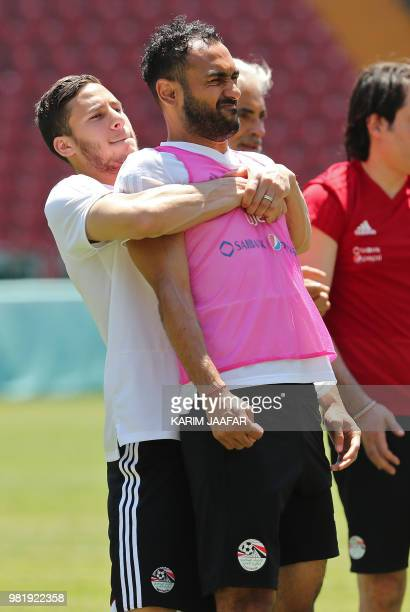 Egypt's midfielder Ramadan Sobhi and Egypt's defender Ahmed Elmohamady exercice together during a training session at the Akhmat Arena stadium in...