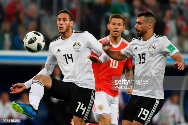 Egypt's midfielder Ramadan Sobhi and Egypt's midfielder Abdallah Said play during the Russia 2018 World Cup Group A football match between Russia and...