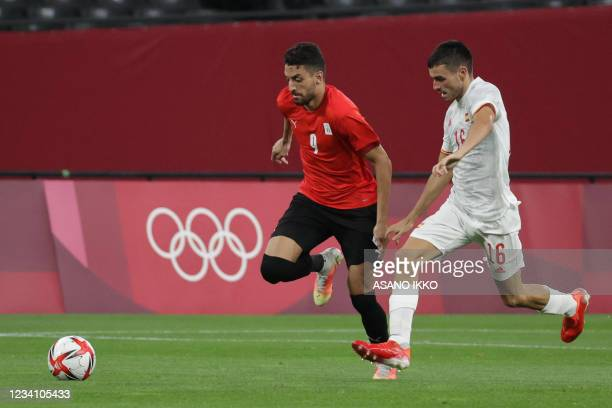 Egypt's midfielder Taher Mohamed competes for the ball with Spain's midfielder Pedri Gonzalez during the Tokyo 2020 Olympic Games men's group C first...