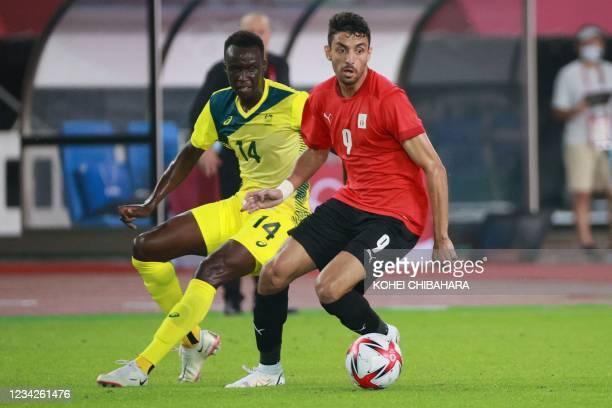 Egypt's midfielder Taher Mohamed controls the ball next to Australia's defender Thomas Deng during the Tokyo 2020 Olympic Games men's group C first...