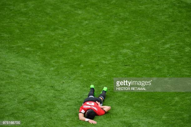 TOPSHOT Egypt's midfielder Tarek Hamed lies on the pitch during the Russia 2018 World Cup Group A football match between Egypt and Uruguay at the...