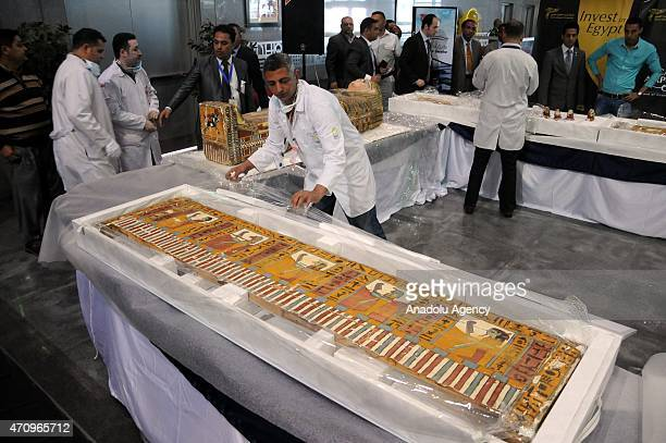 Egypt's Minister of Antiquities and Heritage Mamdouh Eldamaty waits with other officials as 135 pieces of historical artifacts smuggled from Egypt to...