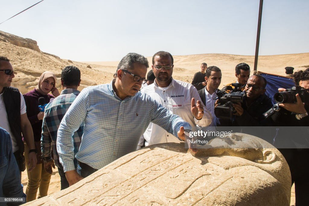 Egypt's Minister of Antiquities Khaled al-Enany looks a sarcophagus that was discovered is displayed at the site of an ancient Egyptian cemetery, in Minya province, 245 km south of Cairo, Egypt, 24 February 2018. According to the Ministry of Antiquities, an ancient Egyptian cemetery was discovered six kilometers north of Tuna al-Gabal archaeological site in Minya, containing a number of burial shafts dating to the late pharaonic period and early Ptolemaic era. The archaeological mission unearthed a mummy decorated with a bronze collar, 1000 figurines, some 40 sarcophagi, four canopic jars, and other funerary items.