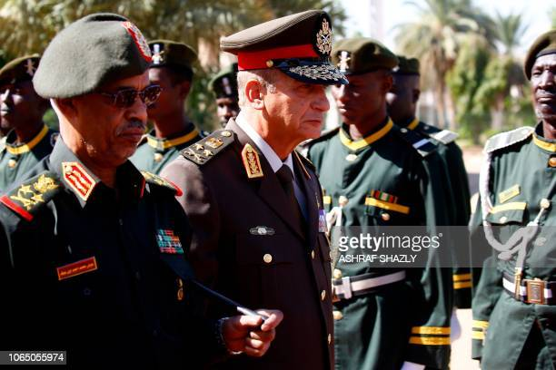 Egypt's Minister of Defence and Military Production Mohamed Ahmed Zaki is welcomed by his Sudanese counterpart Ahmed Awad Ibn Auf in Khartoum on...