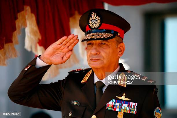 Egypt's Minister of Defence and Military Production Mohamed Ahmed Zaki greets the honour guard before his meeting with his Sudanese counterpart in...