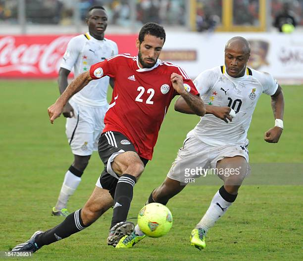 Egypt's Mohamed Aboutrika vies with Ghana's Andre Ayew during the Fifa World Cup 2014 qualifying football match Ghana vs Egypt on October 16 2013 at...