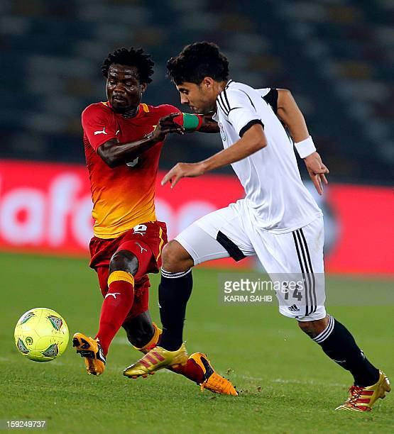 Egypt's Mohamed alNenny fights for the ball against Ghana's Anthony Annan during their friendly football match in Abu Dhabi on January 10 2013 AFP...