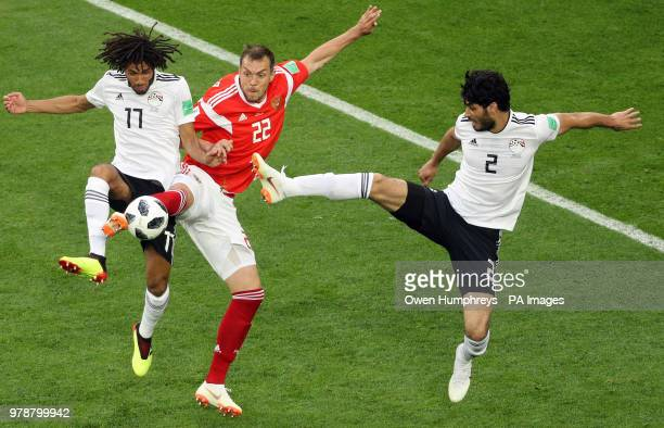 Egypt's Mohamed Elneny and Ali Gabr battle for the ball with Russia's Artem Dzyuba during the FIFA World Cup 2018 Group A match at Saint Petersburg...