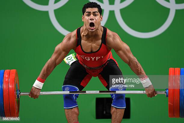 Egypt's Mohamed Mahmoud competes during the Men's 77kg weightlifting competition at the Rio 2016 Olympic Games in Rio de Janeiro on August 10, 2016....