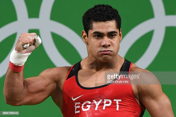 Egypt's Mohamed Mahmoud reacts while competing during the Men's 77kg weightlifting competition at the Rio 2016 Olympic Games in Rio de Janeiro on...