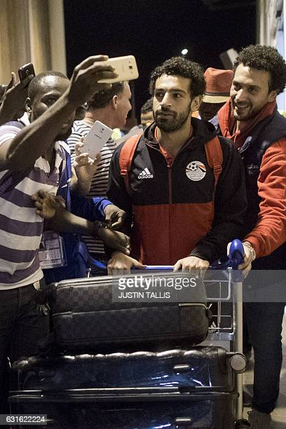 Egypt's Mohamed Salah arrives to the PortGentil International Airport in PortGentil on January 13 to take part in the 2017 Africa Cup of Nations...