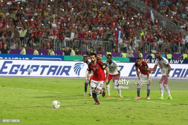 Egypt's Mohamed Salah scores a penalty during their World Cup 2018 Africa qualifying match between Egypt and Congo at the Borg elArab stadium in...