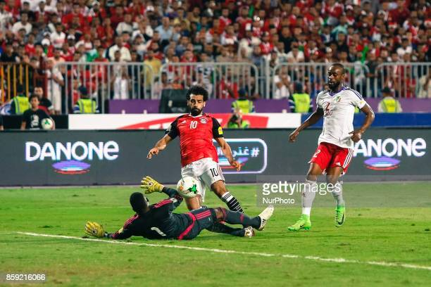 Egypts Mohamed Salah scores first goal during the 2018 World Cup group E qualifying soccer match at the Borg El Arab Stadium in Alexandria Egypt...