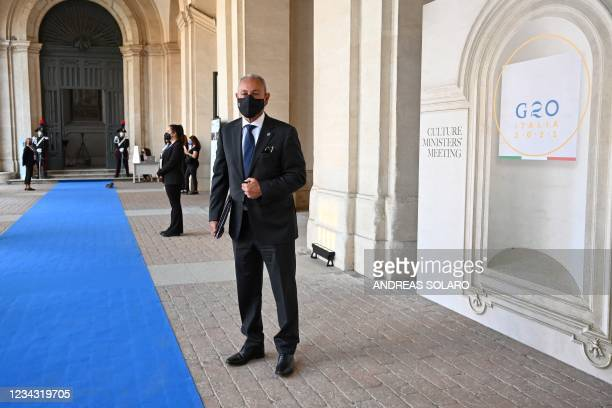 Egypt's Nasser Kamel, Secretary-General of the Union for the Mediterranean , wears a face mask as he arrives for the roundtable of the G20 Culture...