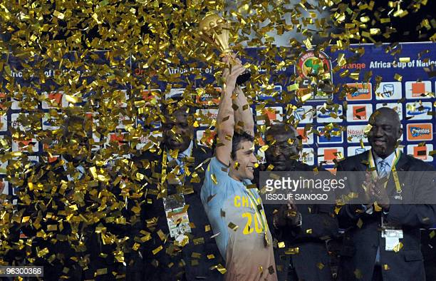 Egypt's National football team captain Ahmed Hassan celebrates with the trophy after their victory against Ghana on january 31 2010 at the November...