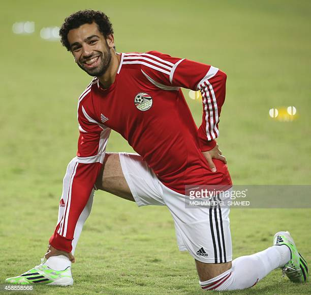 Egypt's national football team player Mohammed Salah who also plays for England's premier league club Chelsea stretches during a training session at...