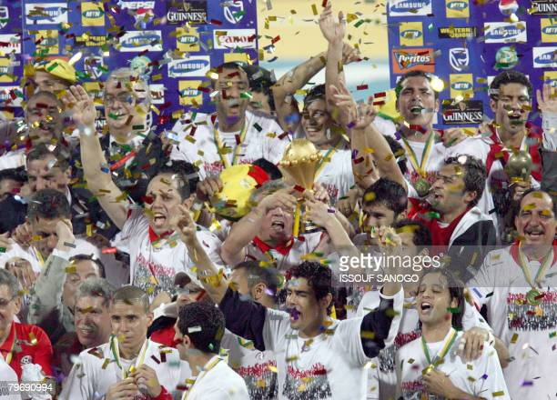 Egypt's national football team players celebrate with the trophy their victory against Cameroon on February 10 2008 in Accra stadium during their...