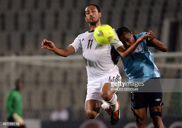 Egypt's national team player Walid Soliman fights for the ball against Botswana's Edwin Olerile during their Africa Cup of Nations 2015 qualifying...