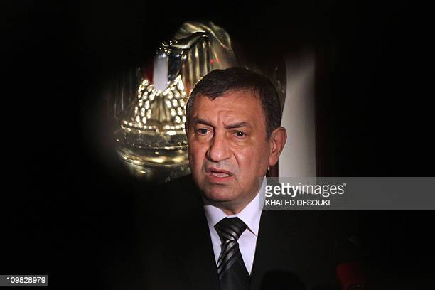 Egypt's new government Prime Minister Essam Sharaf addresses the nation at his office in Cairo on March 7 2011 as new ministers were sworn in today...