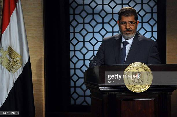 Egypt's new president-elect, Muslim Brotherhood leader Mohamed Morsi, gives a speech in the studio of the state television in Cairo on June 24, 2012...