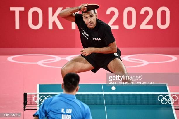 Egypt's Omar Assar competes against Ukraine's Lei Kou during their men's singles round 2 table tennis match at the Tokyo Metropolitan Gymnasium...