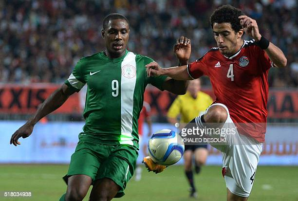 Egypt's Omar Gaber controls the ball as Nigeria's Odion Ighalo defends during their African Cup of Nations group G qualification football match...