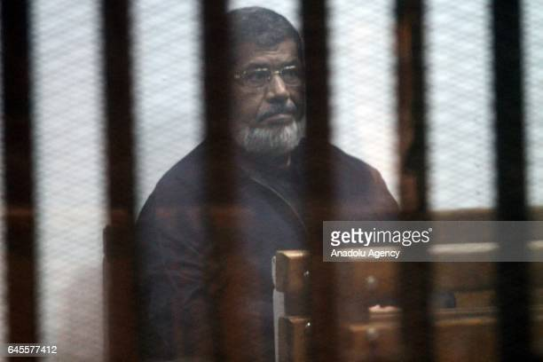Egypts ousted President Mohamed Morsi attends a trial session over the Wadi el-Natrun prison case at Cairo Police Academy in Egypt on February 26,...