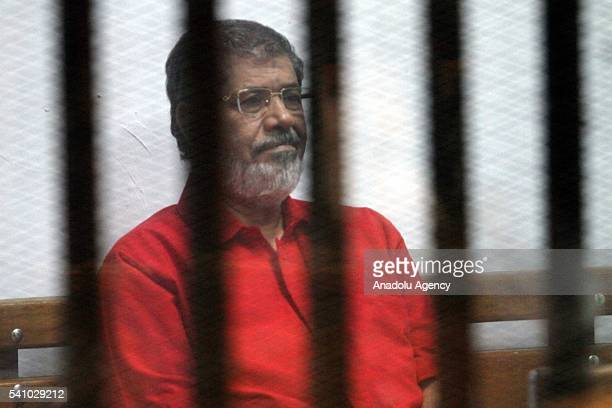 Egypts ousted President Mohamed Morsi is seen behind the bars during his trial on charges of espionage on behalf of Qatar at the Police Academy in...