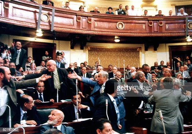 Egypt's parliament members shout 10 May 2005 in Cairo as they discuss a controversial constitutional amendment which changes the rules of...
