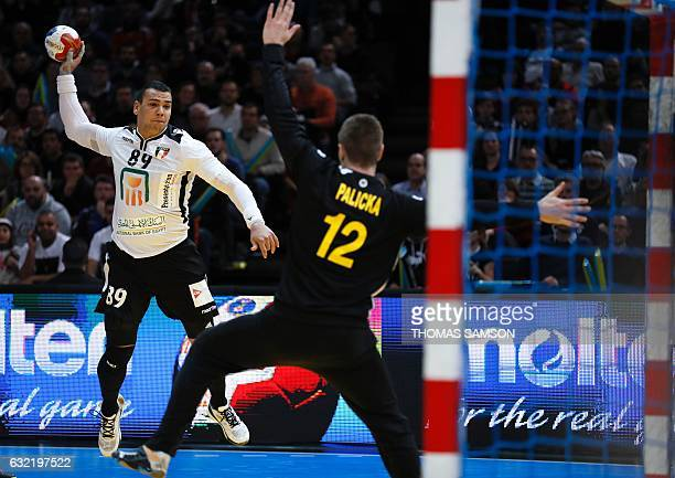 Egypt's pivot Mohamed Mamdouh Shebib prepares to shoot on goal as Sweden's goalkeeper Andreas Palicka stretches out during the 25th IHF Men's World...