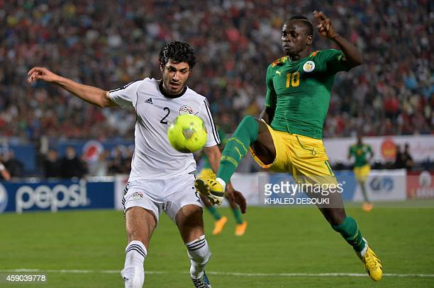 Egypt's player Ali Gaber and Senegal's player Sadio Mane fight for the ball as they are pointed by a laser beam during their Africa Cup of Nations...