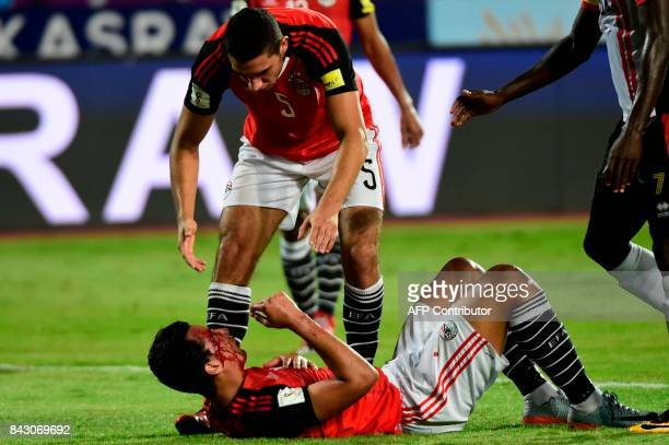 Egypts player Amr Gamal layes on the ground after he injured during football match between Egypt and Uganda in the FIFA World Cup 2018 qualification...