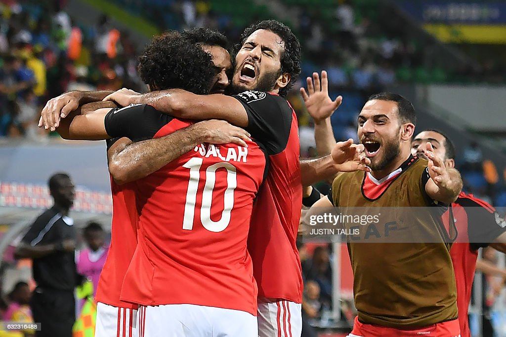 TOPSHOT - Egypt's players celebrate a goal during the 2017 Africa Cup of Nations group D football match between Egypt and Uganda in Port-Gentil on January 21, 2017. / AFP / Justin TALLIS
